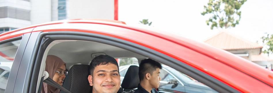 Guy Smiling in car