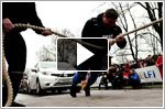 The world's strongest man pulls 12 hatchbacks