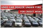 Used car dealer under fire for credit problems