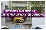Reversing taxi crashes into walkway between two blocks at Jurong West Street 81