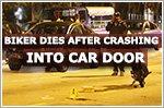 Motorcyclist dies after crashing into car door