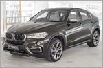 The BMW X6 is one admirable tank of a car